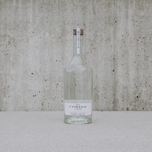 tequila bottle on neutral background