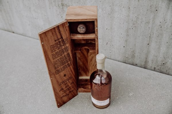 tequila bottle and wooden package