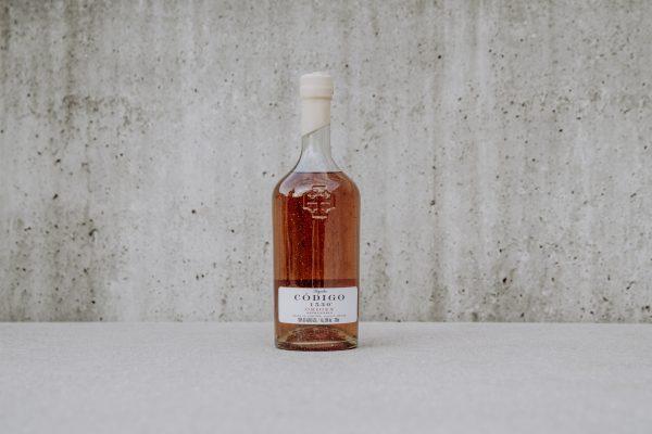tequila bottle codigo origen on neutral background
