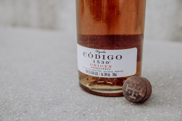 closeup of tequila label and bottle cap