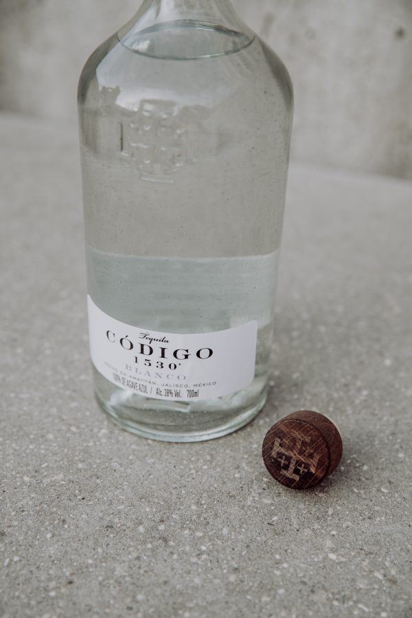 closeup of tequila bottle and cap